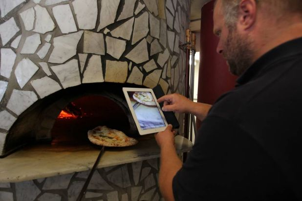 Gabriele Bonci admires the oven at Via Napoli, Lane Cove.