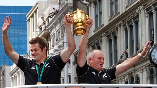 Vindicated ... New Zealand All Blacks captain Richie McCaw, left, holds up the Webb Ellis Cup with coach Graham Henry ...