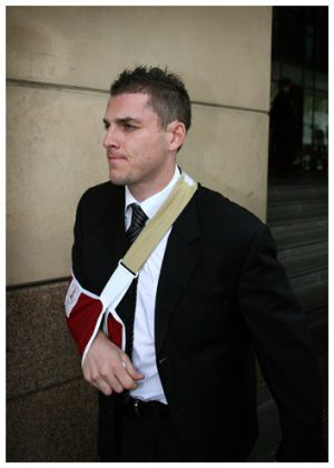 Carlton footballer Heath Scotland leaves Melbourne Magistrates Court in September 2006.