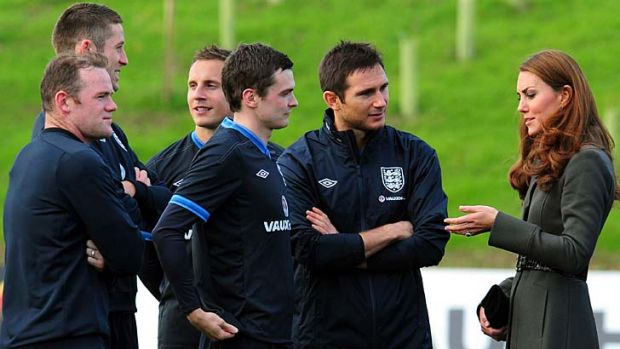 English players speak with the Duchess of Cambridge at the opening of the country's National Football Centre.
