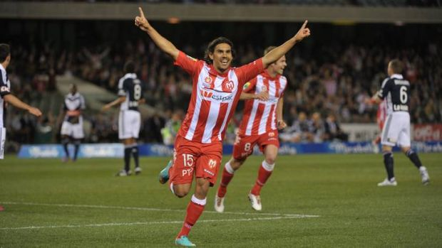 The Melbourne Heart's David Williams celebrates scoring against Melbourne Victory in the A-League opener.