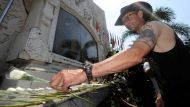 The AgeNews9/10/2012picture Justin McManus.Bali Bombing 10th anniversary memorial.Mourners pay lay floral tributes ...