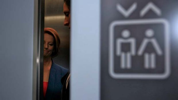"Julia Gillard walks out of a lift after attending the ""Powerful Women Breakfast"" at Old Parliament House on Tuesday."