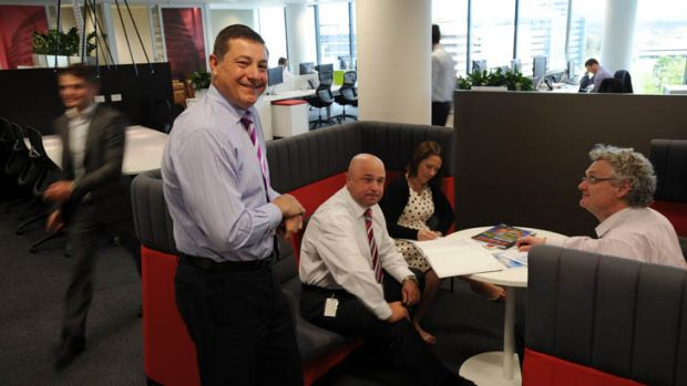 Managing Director ACT of Jones Lang LaSalle, Andrew Balzanelli, left, in the company's Civic office, with some of the staff.