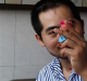 Zhang was repairing a spotlight on an external wall at a Foxconn factory when he received an electric shock and fell ...