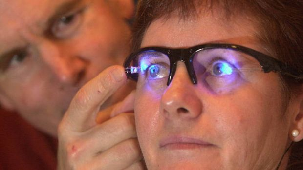 Professor Leon Lack from Flinders University adjusts a prototype of his light-emitting diode (LED) glasses which help ...