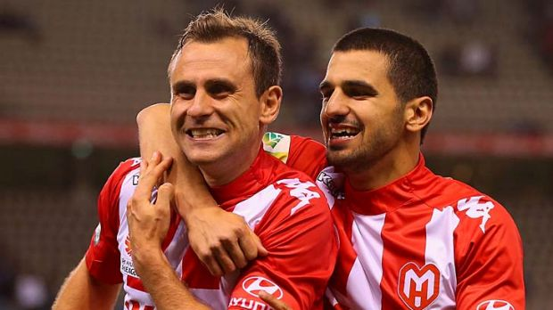 Up for the challenge: Heart's Richard Garcia and Aziz Behich in last week's win.