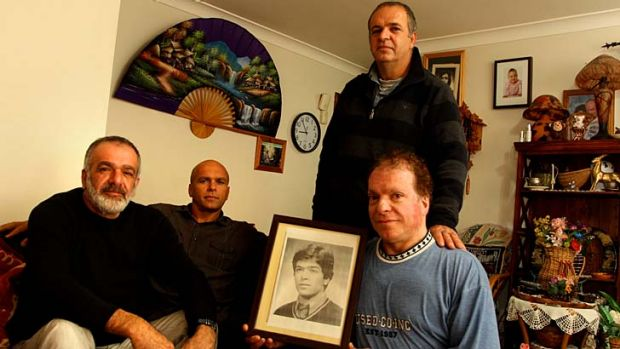 The strength is our family … the Sumer brothers, from left, Mustafa, Ertan, Mehmet with Ali holding a picture of ...