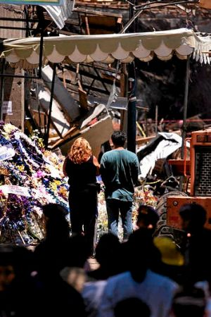 Mourners pay their repects near the Sari Club after the 2002 Bali bombings.
