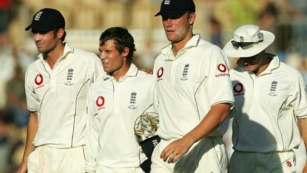 Downcast ... James Anderson (L), trudges off the Adeialde Oval with Geraint Jones and Andrew Flintoff.