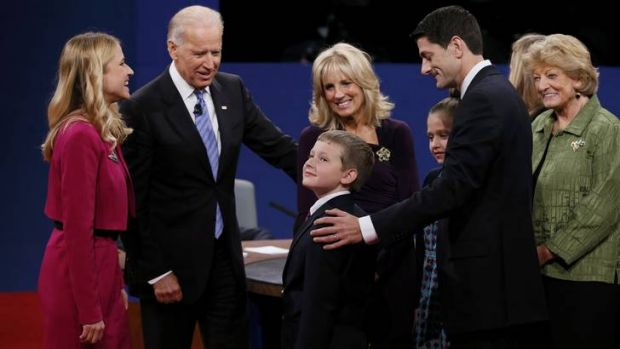 Friendly moment ... members of the Biden and Ryan families greet one another on stage after the debate.