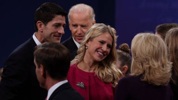 Brittle and passionate debate ... Paul Ryan's wife, Janna, centre, speaks to Joe Biden's wife, Jill, as Mr Ryan, left, ...