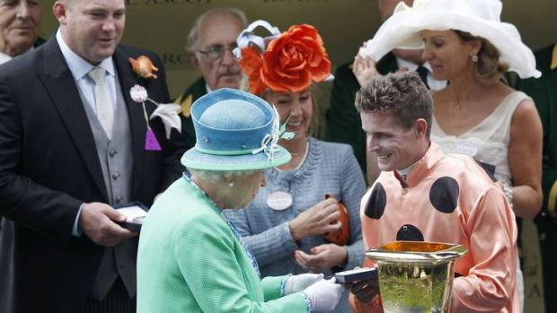 Nolen receiving his winners' memento from the Queen after winning the Diamond Jubilee Stakes at Royal Ascot in June.