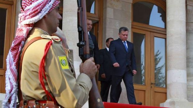 King Abdullah (right) leaves after the swearing-in ceremony for the new cabinet at the Royal Palace in Amman.
