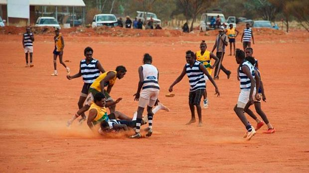 Pure delight: Players compete at a football carnival at the Mutitjulu ground near Uluru.