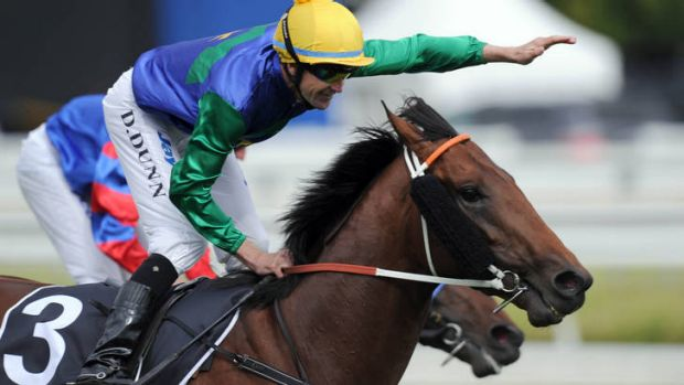 Jockey Dwayne Dunn celebrates after riding All To Hard to win the Caulfield Guineas.