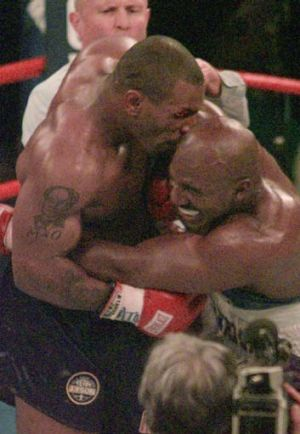 Crunch ... Mike Tyson bites into the ear of Evander Holyfield in their WBA Heavyweight match.