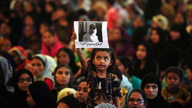 Held high ... a young supporter holds up a photo of Malala Yousafzai.