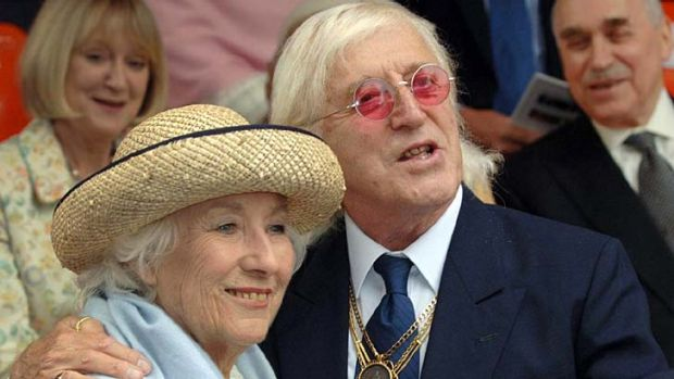 Accused of preying on girls and women ... Jimmy Savile British with singer Vera Lynn.