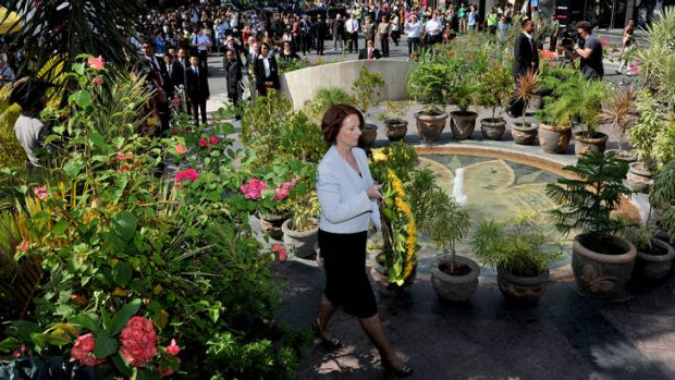 Moved: Julia Gillard pays her respects at the Bali bombings memorial monument.
