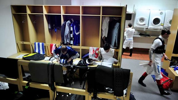 Inner sanctum: The jockeys' room at Caulfield is a busy place as riders prepare for their next mount.