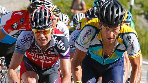 Tough competition: Cadel Evans (left) cycles beside Lance Armstrong during the seventh stage of the 2009 Tour de France.