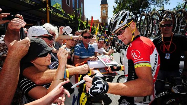 Lance Armstrong signs autographs in 2011.