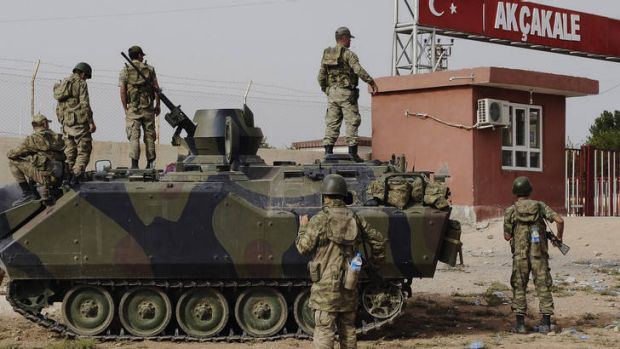 On guard ... Syria and Turkey exchange fire across their troubled border in attacks that look increasingly like an ...