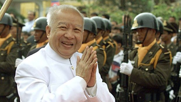 Cambodia's then King Norodom Sihanouk,79, greets his subjects upon his arrival at the annual crop-planting ceremony ...