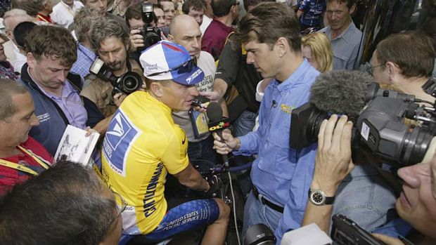 Friends now foes ... Frankie Andreu interviews  Lance Armstrong before stage one of the 2002 Tour De France.