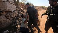 Israelis uproot West Bank olive trees (Video Thumbnail)