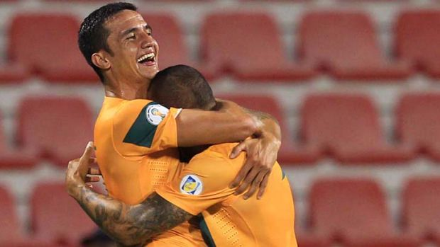 Goal heroes ... Archie Thompson is hugged by Tim Cahil.