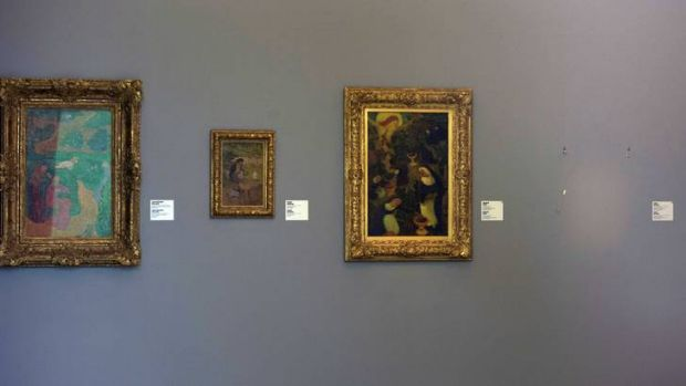 "The empty space where Henri Matisse' painting ""La Liseuse en Blanc et Jaune"" was hanging, right, is seen at Kunsthal ..."