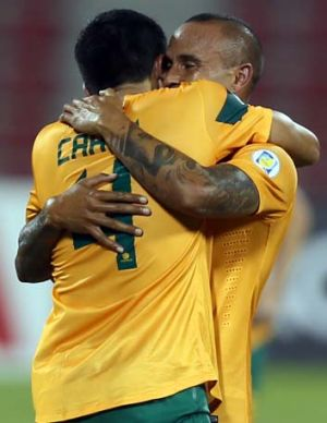 Old timers … Tim Cahill and Archie Thompson embrace.