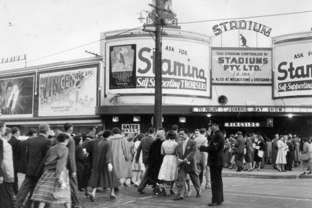 Crowds make their way to Sydney Stadium at Rushcutters Bay, Sydney, for the Johnnie Ray concert, 23 September 1957.