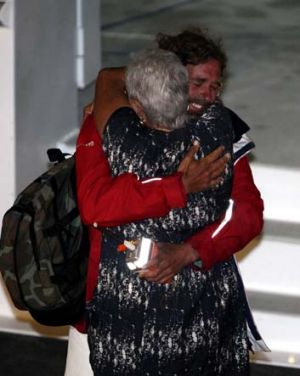 Rescued … Glenn Ey's mother, Colleen, greets him in Sydney yesterday. <i>Photo: NSW Police</i>