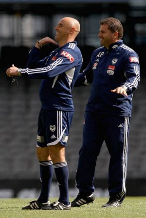 Melbourne Victory assistant coach Kevin Muscat, left, and head coach Ange Postecoglou at training yesterday.