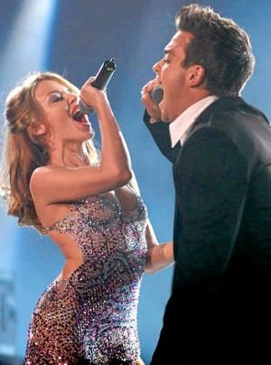 British singer Robbie Williams performs with Australian singer Kylie Minogue at the MTV Europe music awards in Stockholm ...