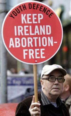 A protester outside the Belfast clinic.