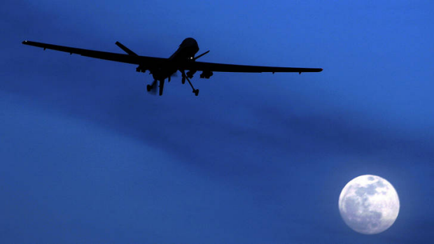 Moonlight shadow ... a US Predator flies over Kandahar in southern Afghanistan.