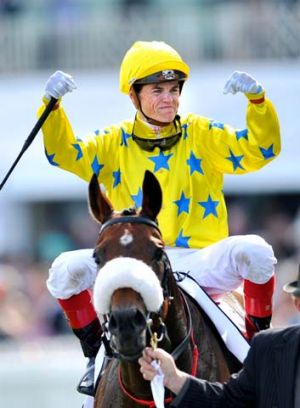Craig Williams shows his joy after riding Dunaden to victory in the Caulfield Cup.