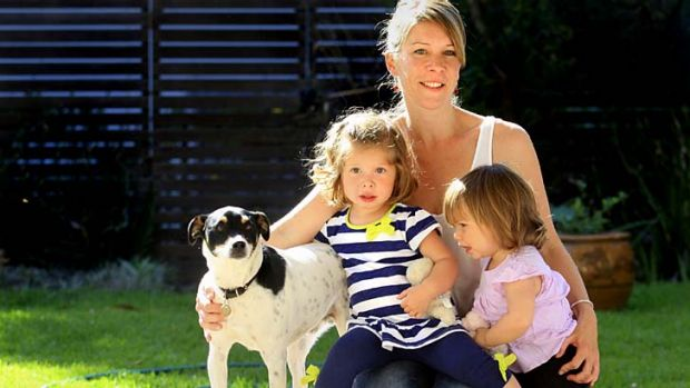 """""""You have to take what you can get"""" ... Liz Budnik and her two daughters, April and Astrid."""