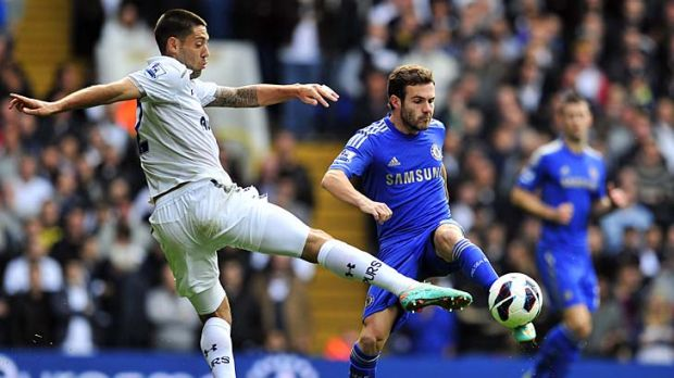 Tottenham Hotspur's US striker Clint Dempsey (left) vies for the ball with Chelsea's Spanish midfielder Juan Mata when ...