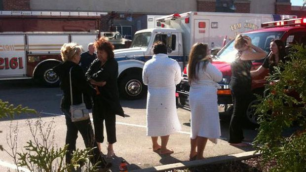 Clients and staff in the car park outside Azana Spa in Wisconsin, the scene of a shooting spree.