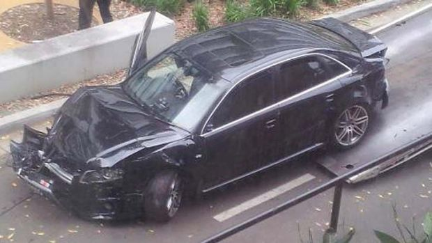 Smashed up ... this car was towed away from UNSW, a witness said.