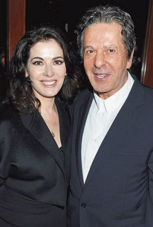 Power couple … with her second husband, Charles Saatchi, in January 2012.