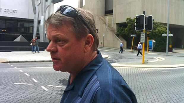 Andrew Devine leaves the coronial inquest.