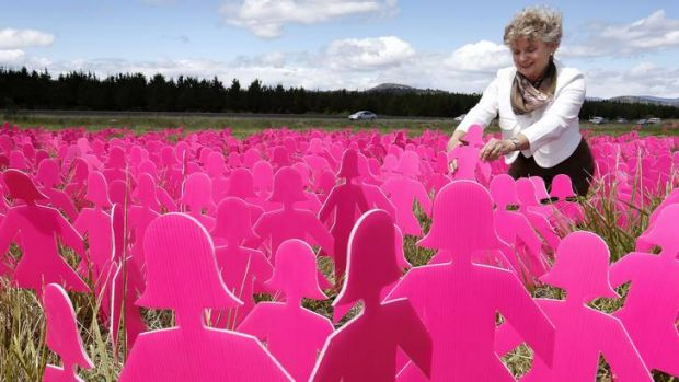 Lucy Costas from Carwoola puts a pink lady in the field of 6,000 Pink Lady silhouettes at the National Arboretum.