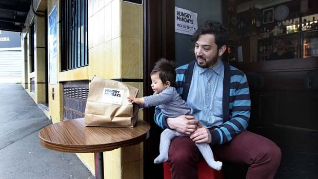 In great demand ... Omar Andrade, pictured with daughter Eva, has started Hungry Mondays, a business selling home-cooked ...