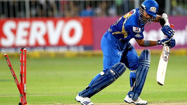 Death rattle ... Sachin Tendulkar, playing for the Mumbai Indians, is bowled by Moises Henriques of the Sydney Sixers.
